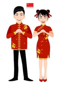 Maschio e femmina cinesi in costume tradizionale, saluto del popolo cinese e bandiera cinese sul personaggio dei cartoni animati bianco del fondo