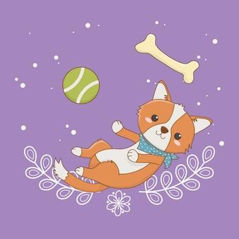 Mascotte sveglia del piccolo cane con il giocattolo della palla e dell'osso