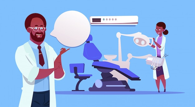 Medici afroamericani team over dental office equipment dentista hospital