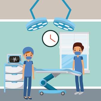 Medici nella finestra delle luci del letto di chirurgia della stanza di ospedale