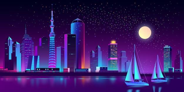 Megapolis al neon sul fiume con gli yacht