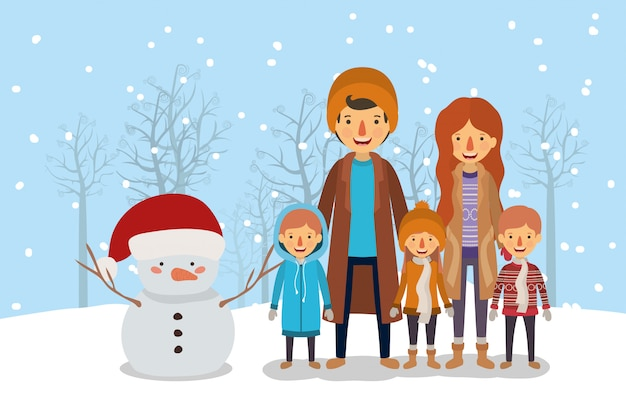 Membri della famiglia che celebrano natale nello snowscape