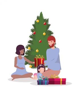 Membri della famiglia con albero di natale