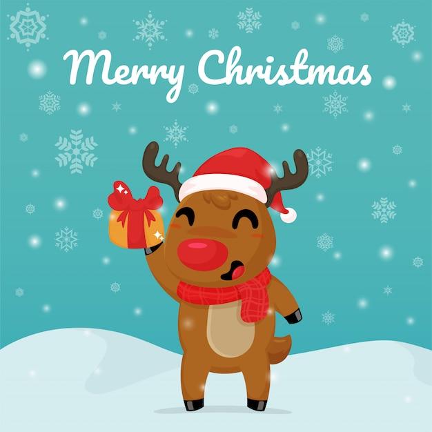Merry christmas card, cartoon reindeer in possesso di una confezione regalo.