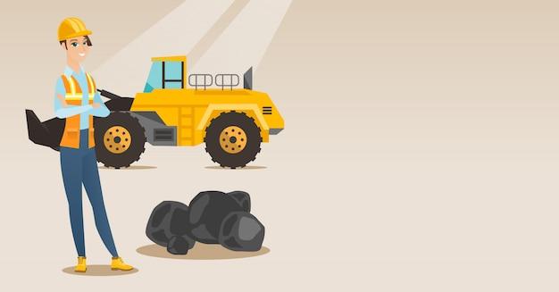 Minatore con un grande escavatore