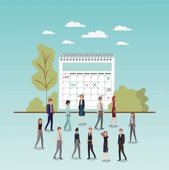 Mini persone con promemoria del calendario
