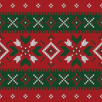 Modello a maglia di natale. inverno modello geometrico senza soluzione di continuità.