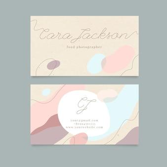 Modello astratto del biglietto da visita con le macchie colorate pastello