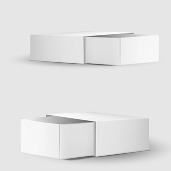 Modello della scatola di cartone o della carta in bianco su bianco.