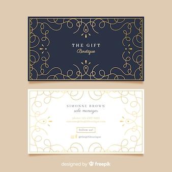 Modello di biglietto da visita dorato ornamentale
