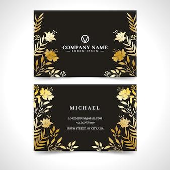 Modello di biglietto da visita floreale dorato