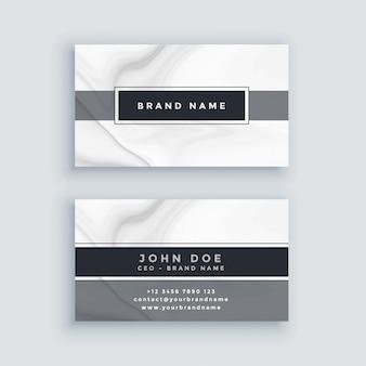Modello di biglietto da visita grigio elegante con sfondo di marmo