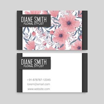 Modello di biglietto da visita modello con texture colorate e fiori, foglie, erbe.