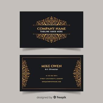 Modello di biglietto da visita nero e dorato
