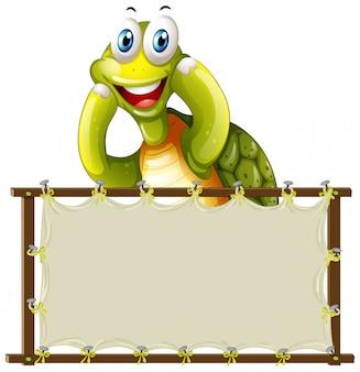 Modello di bordo con tartaruga carino su sfondo bianco