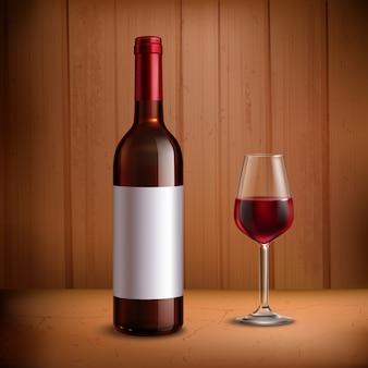 Modello di bottiglia di vino con un bicchiere di vino rosso