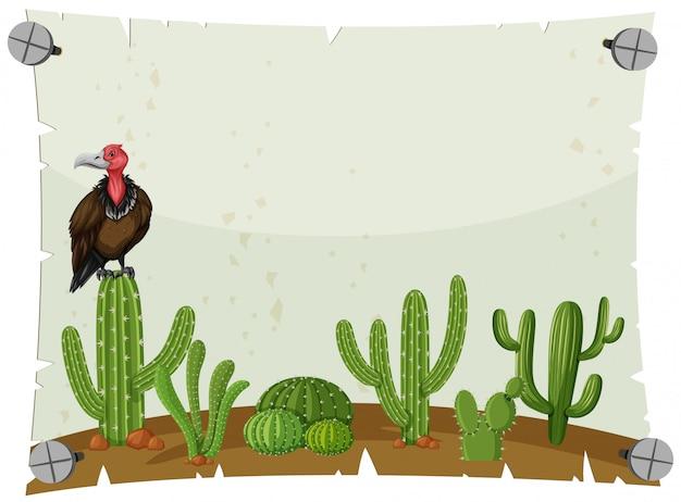 Modello di carta con avvoltoio nel giardino di cactus
