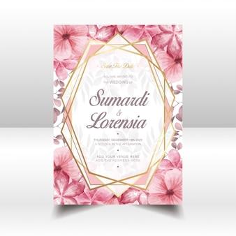 Modello di carta di nozze con fiori ad acquerelli e cornice dorata