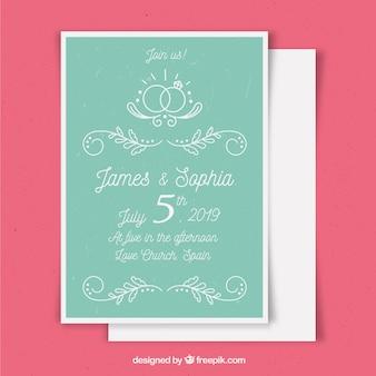 Modello di carta di nozze con ornamenti disegnati a mano