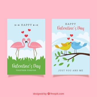 Modello di carta di san valentino con uccelli e fenicotteri