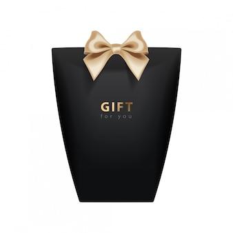 Modello di confezione regalo. realistico pacchetto nero con fiocco dorato