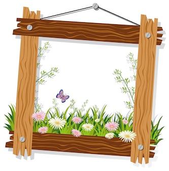 Modello di cornice in legno con fiori ed erba