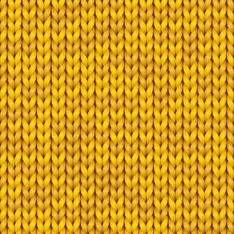 Modello di lavoro a maglia. fondo senza cuciture realistico lavorato a maglia di colore giallo. trama a maglia per sfondi e sfondi.