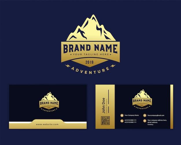 Modello di logo montagna dorata