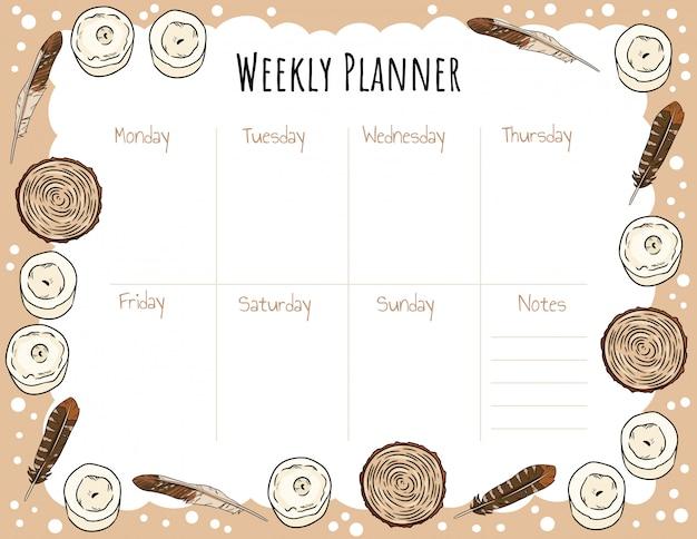 Modello di planner settimanale con candele, piume e scarabocchi di sezioni comiche di taglio di legno.