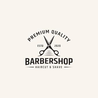 Modello di progettazione di logo del negozio di barbiere