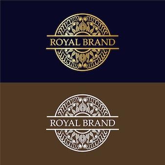 Modello di progettazione di logo di lusso dorato disegnato a mano