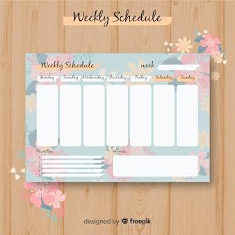 Modello di programma settimanale adorabile con stile floreale
