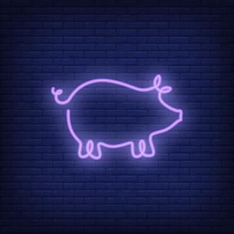 Modello di segno di neon forma di maiale. pubblicità luminosa di notte.