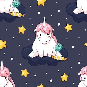 Modello di unicorno senza cuciture disegnato a mano con stelle e caramelle