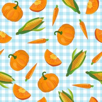 Modello di verdure disegnato simboli di carota e mais zucca sulla tovaglia a scacchi blu chiaro