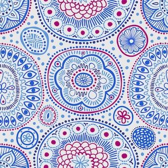 Modello etnico senza cuciture con punti e cerchi dettagliati in blu.