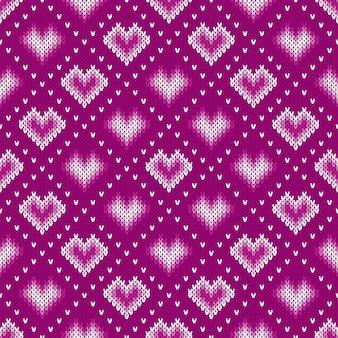 Modello lavorato a maglia con cuori. sfondo senza soluzione di continuità