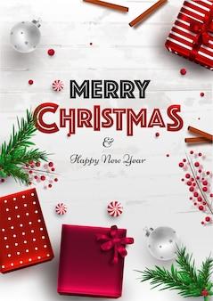 Modello o volantino di buon natale e felice anno nuovo con vista dall'alto di scatole regalo, foglie di pino, bacche e bagattelle