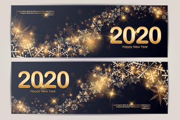 Modello panoramico dell'insegna con il pizzo di colori dell'oro e dei coriandoli del fiocco di neve della stella della palla di natale per testo 2020
