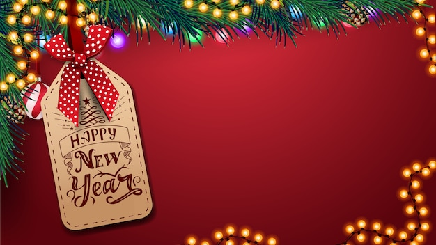 Modello rosso per biglietto di auguri con sfondo spazio copia, bella scritta sul prezzo, decorazioni natalizie e ghirlanda