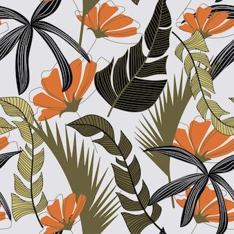 Modello senza cuciture alla moda con foglie e fiori tropicali colorati