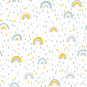 Modello senza cuciture arcobaleno e gocce di pioggia in colori pastello. illustrazione disegnata a mano scandinava del bambino ideale per tessuti e vestiti neonati