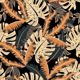 Modello senza cuciture astratto con le foglie e le piante tropicali variopinte su fondo nero