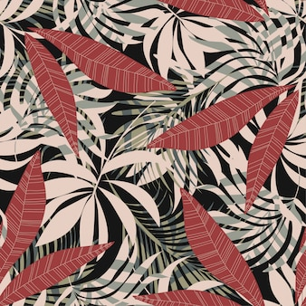 Modello senza cuciture astratto originale con foglie e piante tropicali colorate su uno sfondo scuro