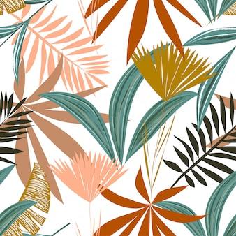 Modello senza cuciture con foglie e fiori tropicali