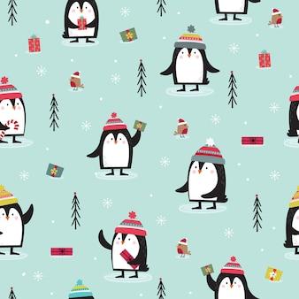 Modello senza cuciture con pinguino, robin, regalo e albero di natale in blu.