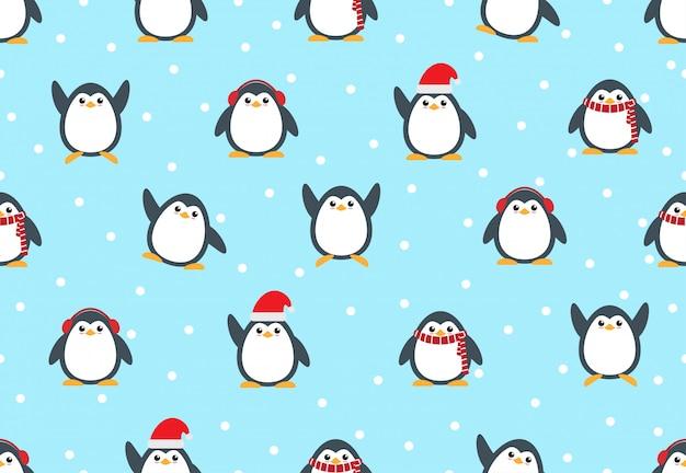 Modello senza cuciture del fumetto sveglio del pinguino con il fondo della neve