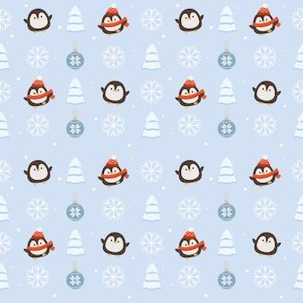 Modello senza cuciture del pinguino carino con palla di natale e albero di natale e fiocchi di neve sul blu
