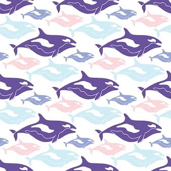 Modello senza cuciture di balene nei colori blu, rosa e viola.