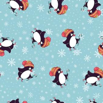 Modello senza cuciture di buon natale con i pinguini, nel vettore.